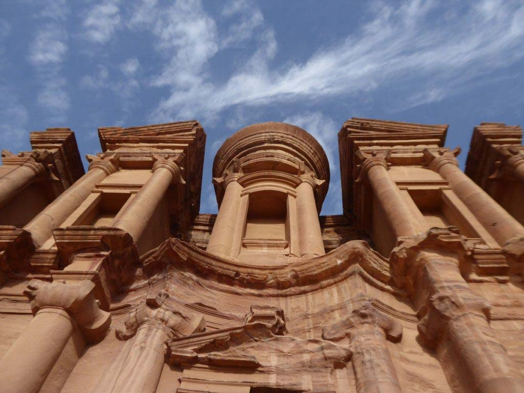 Hiking in Petra to the Monastery, the biggest tomb in Petra. View straight up the facade