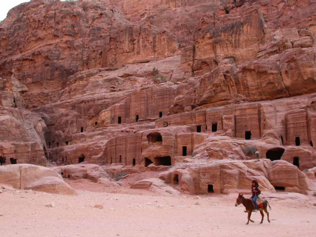 street of facades Petra Jordan, tombs, donkey with rider, hiking in Petra