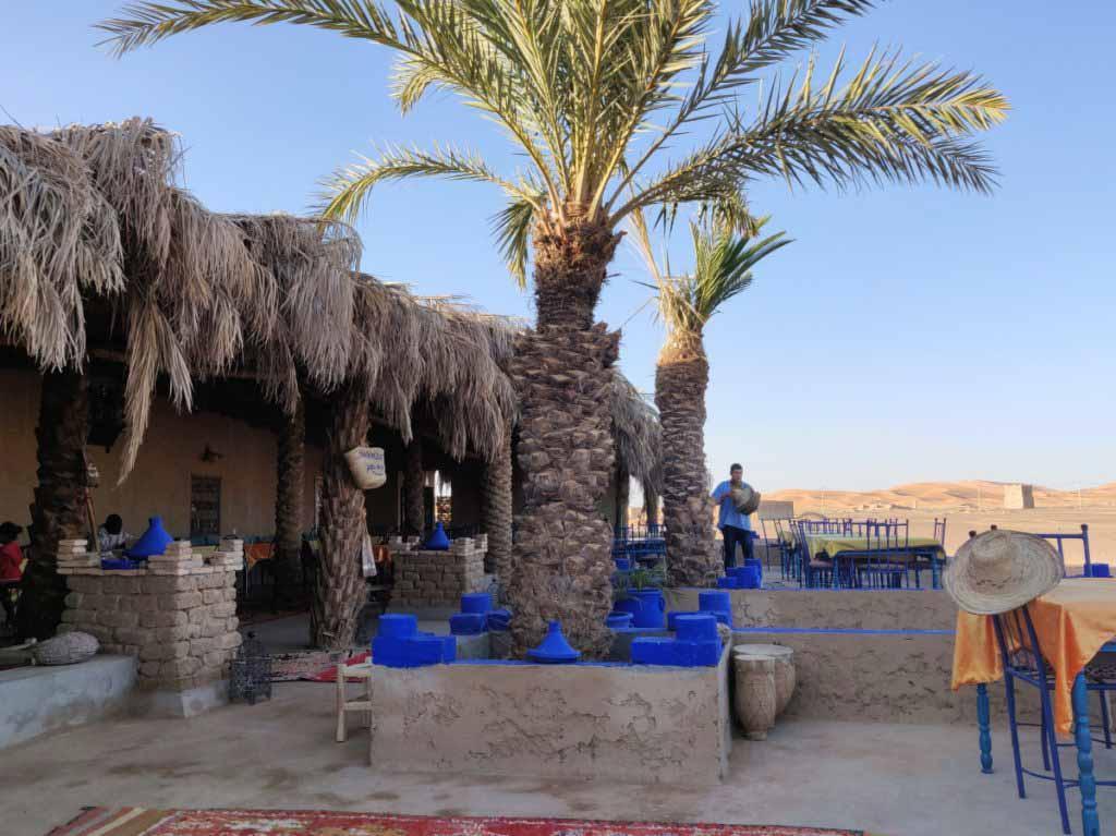 restaurant, cafe Nora Khamlia, palm trees, where to eat in Merzouga