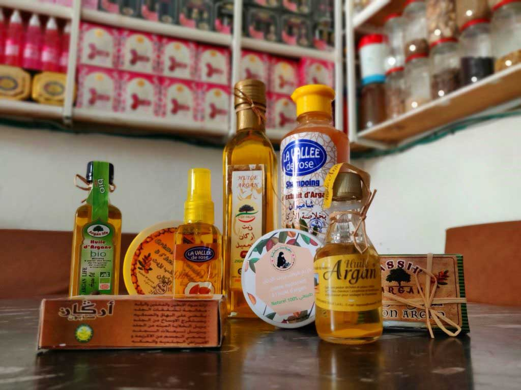 different Argan oil products like shampoo and soap in a shop
