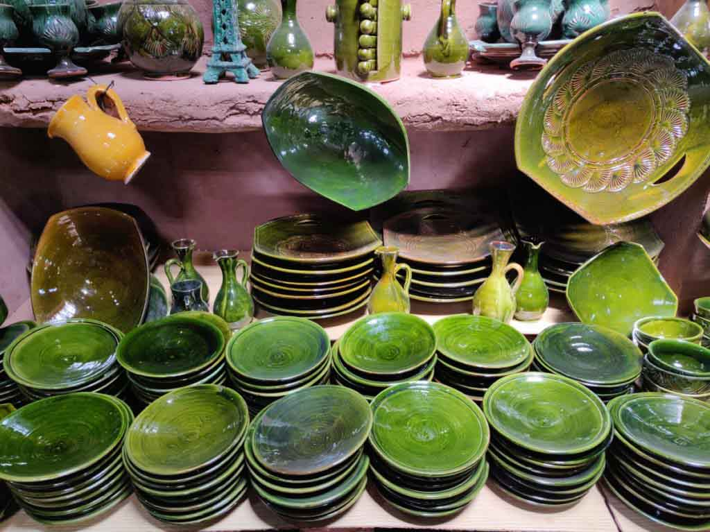 Green plates and bowls in a ceramics shop in Tamegroute Morocco