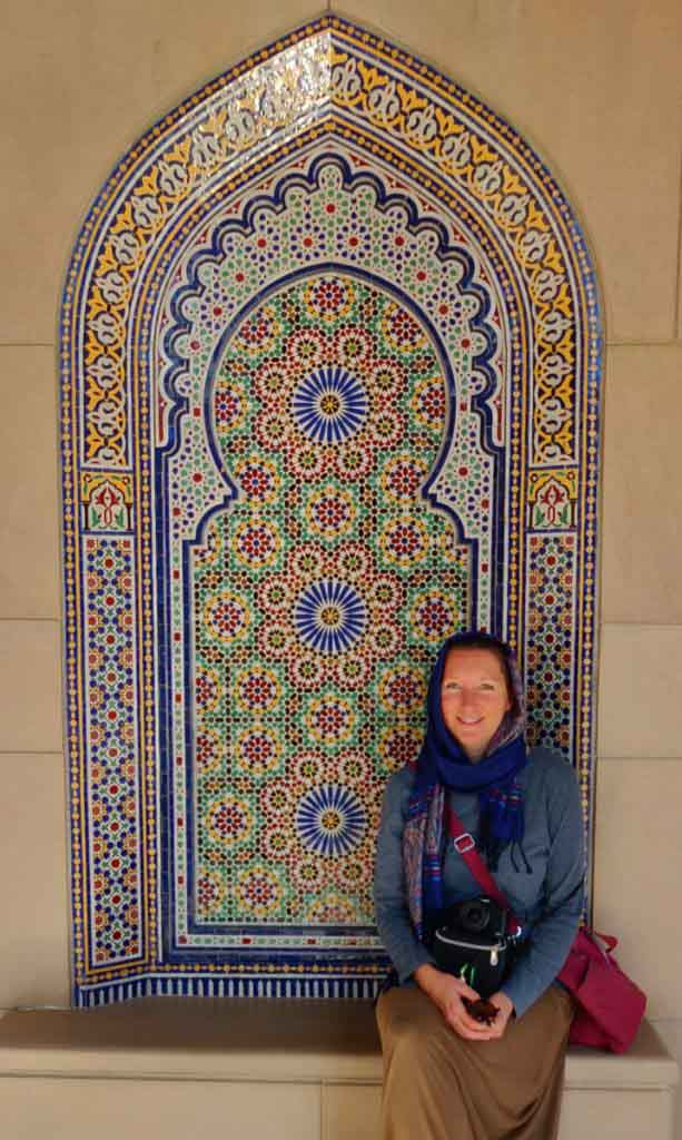 women in front of colourful mosaics, Sultan Qaboos Grand Mosque, Muscat Oman