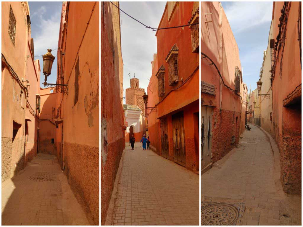 Alleys in the medina of Marrakech, orange and red colours, people walking