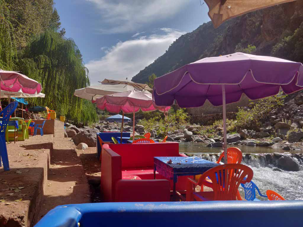 Chairs and tables on the river of Ourika valley, great for a day trip from Marrakech in the summer