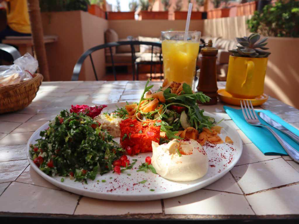 Tabouleh, Hummus and salad, orange drink