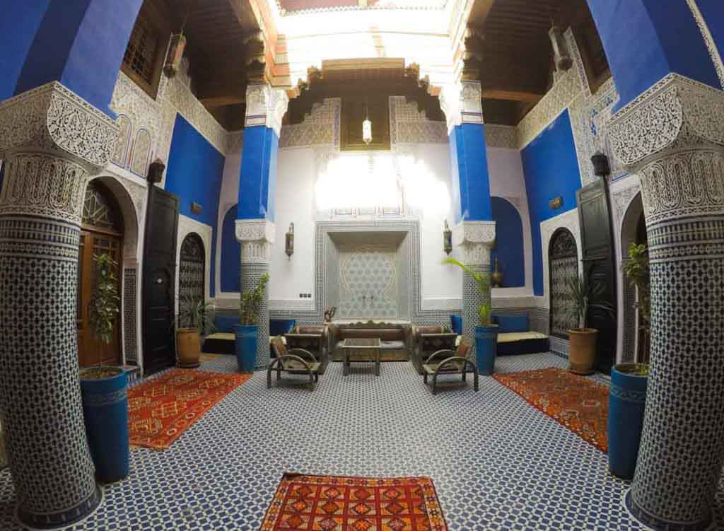 Courtyard of Riad in Morocco, blue and white decorations and tiles.