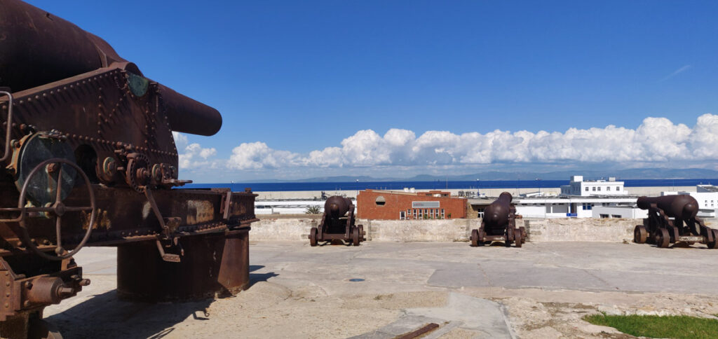 Cannons on city wall pointed at the sea towards Spain. Spain visible on horizon. Tangier, Morocco