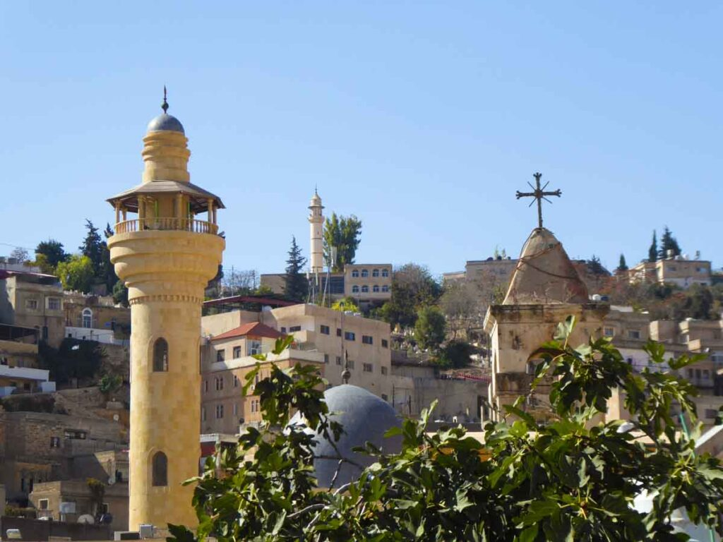 day trip from Amman to As Salt, multiple churches and mosques all in one view of the city