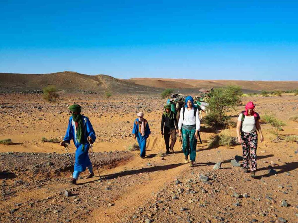 group of people hiking in the moroccan desert with Berber Adventure Tours